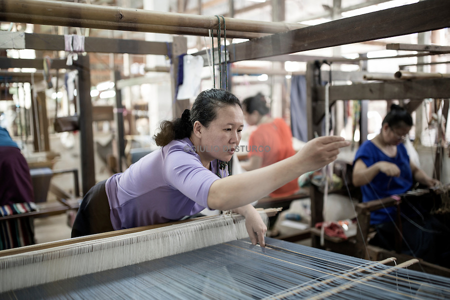 LAOS, NOVEMBER 2015<br />At Carol Cassidy's Lao Textiles workshop, studio and gallery in Vientiane, a team of predominantly female weavers use hybrid looms, which Carol designed herself, to produce intricate brocade, ikat and tapestry textiles. Vientiane, Laos 2015.@Giulio Di Sturco