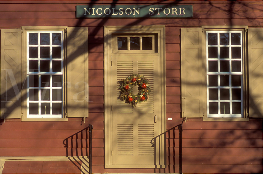 Colonial Williamsburg, Virginia, VA, Williamsburg, A wreath made of greens and fruit decorate the door of Nicholson Store for Christmas in Colonial Williamsburg.