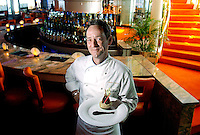 Saturday, Setember 10, 2005.Jimmy Gibson, Executive Chef at South Beach Grill in Covington, shows off the new interior and menu. He is displaying a new appetizer of confit of crispy duck drumstick with ginger applesauce, chinese apple coulis. Photo by The Enquirer/ Sarah Conard sc