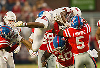 NWA Democrat-Gazette/BEN GOFF @NWABENGOFF<br /> Rakeem Boyd, Arkansas running back, gets stopped by Josiah Coatney (40), Ole Miss defensive end, and Jon Haynes, Ole Miss strong safety, in the first quarter Saturday, Sept. 7, 2019, at Vaught-Hemingway Stadium in Oxford, Miss.