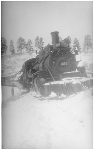 Front view of leased D&amp;RGW #452.  Tender is derailed and tipped behind southbound engine at MP 151.4 on the RGS.<br /> RGS  Mule Shoe Curve, CO  1946