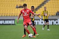Kenny Cunningham and Michael Marrone during the A League - Wellington Phoenix v Adelaide United, Wellington, New Zealand on Sunday 30 March 2014. <br /> Photo by Masanori Udagawa. <br /> www.photowellington.photoshelter.com.