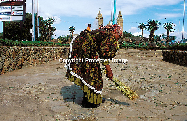 COLESOT35071.Lesotho. A woman sweeping in central Maseru before the King and Queen of Lesotho wedding. Lesotho. February 2000..©Per-Anders Pettersson/iAfrika Photos