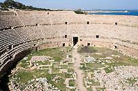 Leptis Magna, Libya - Roman Ampitheater, 1st. Century A.D.  Al-Khoms in distance.