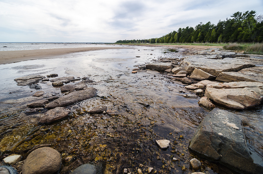 A small streaming into Lake Michigan on a secluded beach. Manistique, MI