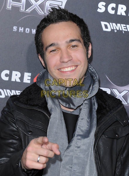 PETE WENTZ .at the Weinstein World Premiere of 'Scream 4' held at The Grauman's Chinese Theatre in Hollywood, California, USa, April 11th 2011..half length grey gray black hand scarf smiling finger pointing gesture .CAP/RKE/DVS.©DVS/RockinExposures/Capital Pictures.