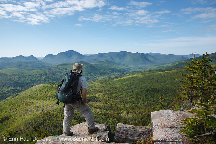 Zealand Notch  - A hiker takes in the view of the Pemigewasset Wilderness from the summit of Zeacliff during the summer months. Located along the Appalachian Trail in the White Mountains, New Hampshire USA
