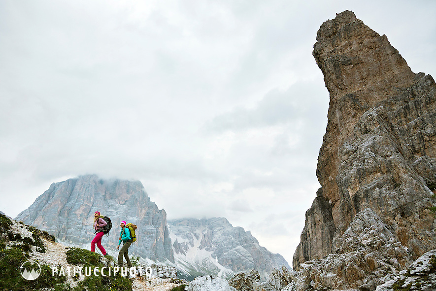 Two female climbers hiking to the Italian Dolomites Cinque Torri