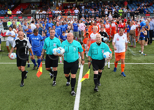June 17th 2017, Gander Green Lane, Sutton, England; Football Charity Match; Chelsea Legends versus Rangers Legends; Referee Lewis Gordon leads the teams out for kick off