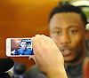 Brandon Marshall #15 New York Jets wide receiver appears on a cell phone as he speaks to the media in the locker room after team practice at the Atlantic Health Jets Training Jets Training Center in Florham Park, NJ on Wednesday, Dec. 30, 2015.