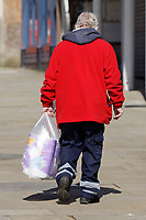 Pictured: A shopper with a bag of toilet rolls in Swansea, Wales, UK. Sunday 22 March 2020<br /> Re: Covid-19 Coronavirus pandemic, UK.