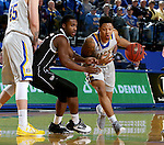 BROOKINGS, SD - JANUARY 7:  Andre Wallace #20 from South Dakota State University looks to get a step past KJ Robinson #5 from the University of Nebraska Omaha during their game Saturday afternoon at Frost Arena in Brookings. (Dave Eggen/Inertia)