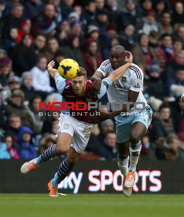 Aston Villa's Nathan Baker battles with West Ham United's Carlton Cole  -  08/02/2014 - SPORT - FOOTBALL - Birmingham - Villa Park - Aston Villa v West Ham United - Barclays Premier League<br /> Foto nph / Meredith<br /> <br /> ***** OUT OF UK *****