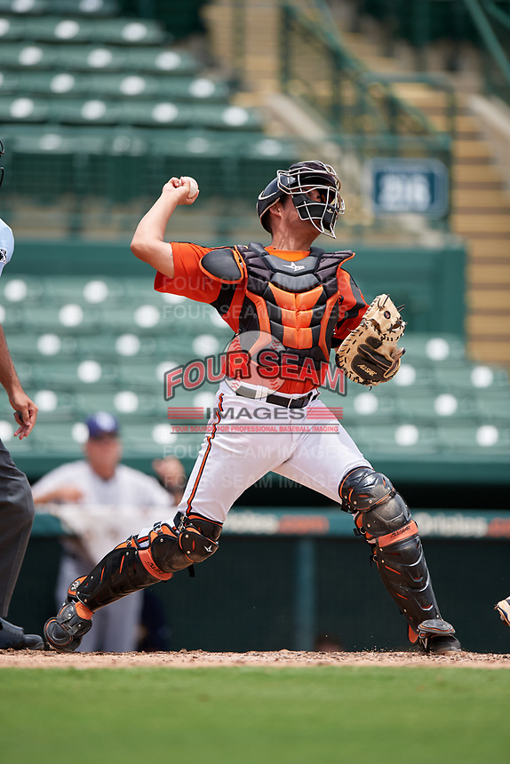 GCL Orioles catcher Alfredo Gonzalez (34) throws to second base on a stolen base attempt during a game against the GCL Rays on July 21, 2017 at Ed Smith Stadium in Sarasota, Florida.  GCL Orioles defeated the GCL Rays 9-0.  (Mike Janes/Four Seam Images)