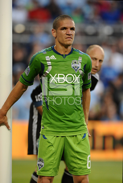 Osvaldo  Alonso (6) midfielder Seattle Sounders on the near post for a corner..... Sporting Kansas City were defeated 1-2 by Seattle Sounders at LIVESTRONG Sporting Park, Kansas City, Kansas.