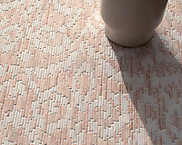 Indira, a hand-cut tumbled mosaic, shown in Desert Pink and Calacatta Tia, is part of the Tissé® collection for New Ravenna.