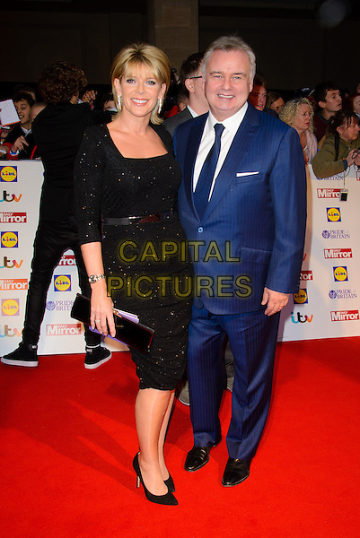 Ruth Langsford &amp; Eamonn Holmes<br /> The Daily Mirror's Pride of Britain Awards arrivals at the Grosvenor House Hotel, London, England.<br /> 7th October 2013<br /> full length black dress blue suit married husband wife <br /> CAP/CJ<br /> &copy;Chris Joseph/Capital Pictures