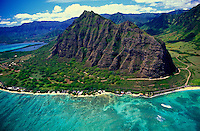 Aerial view of Haloa Ridge and Kaaawa Valley along Oahu's eastern coastline. Kualoa Ranch surrounds this ridge and the Kaaawa valley is a popular location for many outdoor adventure activities and is also known for being a location for many hollywoo