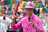Covent Garden, London, UK. 11 May 2014. A children's entertainer is dressed in a pink policeman's uniform. The Covent Garden May Fayre and Puppet Festival takes place at St Paul's Church.