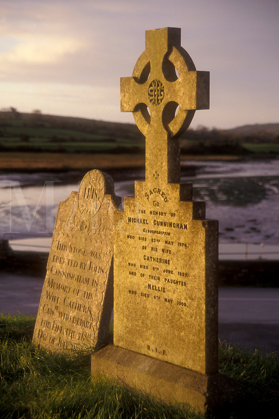 AJ0977, Europe, Republic of Ireland, Ireland, A Celtic Cross on an old gravestone in a cemetery in Timoleague in County Cork.