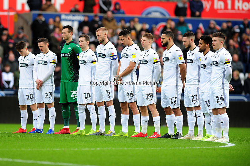 Players from Swansea City take part in a minutes silence during the Sky Bet Championship match between Swansea City and Millwall at the Liberty Stadium in Swansea, Wales, UK. Saturday 09 February 2019