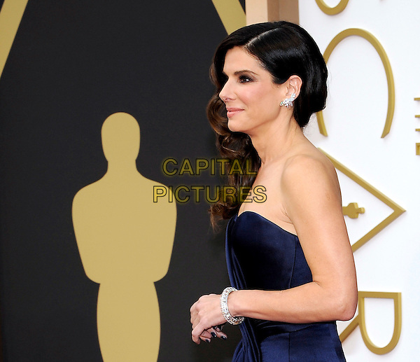 HOLLYWOOD, CA - MARCH 2: Sandra Bullock arriving to the 2014 Oscars at the Hollywood and Highland Center in Hollywood, California. March 2, 2014. <br /> CAP/MPI/COR<br /> &copy;Corredor99/ MediaPunch/Capital Pictures