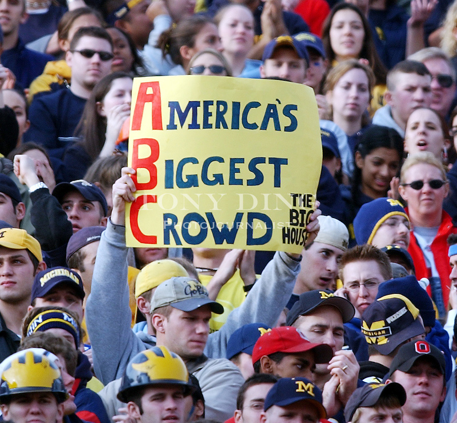 A Michigan fan holds up a sign showing that the Big House has the largest NCAA Football attendance record with a record-breaking 112,118 during the Wolverine's 35-21 upset of Ohio State on Saturday, November 22, 2003 in Ann Arbor, Mich. This was the 100th rivary match between UM and OSU. (TONY DING/The Michigan Daily)
