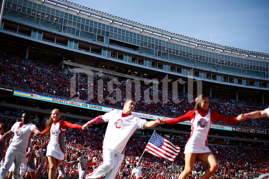 Ohio State Buckeyes cheerleaders celebrate a touchdown in the fourth quarter of the college football game between the Ohio State Buckeyes and the Maryland Terrapins at Ohio Stadium in Columbus, Saturday afternoon, October 10, 2015. The Ohio State Buckeyes defeated the Maryland Terrapins 49 - 28. (The Columbus Dispatch / Eamon Queeney)