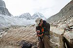Snow Leopard (Panthera uncia) biologist, David Cooper, checking gps for kill site locations, Sarychat-Ertash Strict Nature Reserve, Tien Shan Mountains, eastern Kyrgyzstan