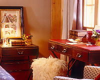 Detail of a matching black and red leather desk and bedside table in the bedroom