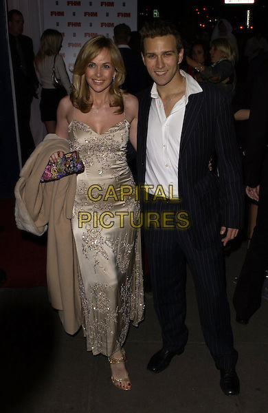 STEFAN BOOTH & GUEST.The FHM 100 Sexiest Women In The World Party 2006 at Madame Tussauds, London, UK. .May 3rd, 2006.Ref: CAN.full length beige black pinstripe suit.www.capitalpictures.com.sales@capitalpictures.com.©Capital Pictures