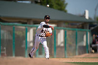 Modesto Nuts third baseman Kevin Santa (4) makes a throw to first base during a California League game against the Lake Elsinore Storm at John Thurman Field on May 13, 2018 in Modesto, California. Lake Elsinore defeated Modesto 4-3. (Zachary Lucy/Four Seam Images)