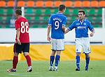 St Johnstone v FC Minsk...01.08.13 Europa League Qualifier at Neman Stadium, Grodno, Belarus...<br /> Paddy Cregg and Steven MacLean shakes hands at full time as Mikita Bukatkin trudges off<br /> Picture by Graeme Hart.<br /> Copyright Perthshire Picture Agency<br /> Tel: 01738 623350  Mobile: 07990 594431