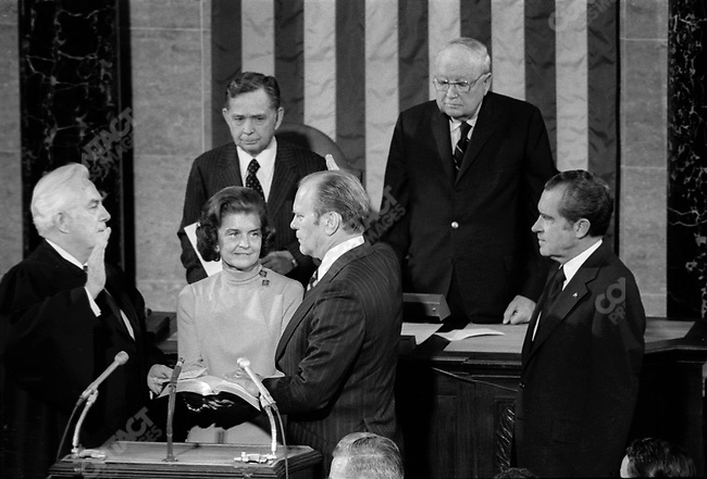 Gerald Ford, being sworn into the vice-presidency, accompanied by his wife, Betty, and President Richard Nixon, Washington, DC, USA, December 6, 1973