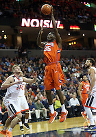 Clemson center Landry Nnoko (35) shoots over Virginia center Jack Salt (33) during an ACC basketball game Tuesday Jan. 19, 2016, in Charlottesville, Va. (Photo/Andrew Shurtleff)
