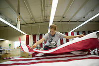 21 June 2005 - Oaks, PA - Wanda Domena spreads out the red and white part of an American flag at the Annin & Co. American flag manufacturing plant in Oaks, PA. Photo Credit: David Brabyn.