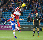 Harry Forrester rises high to power a header towards goal