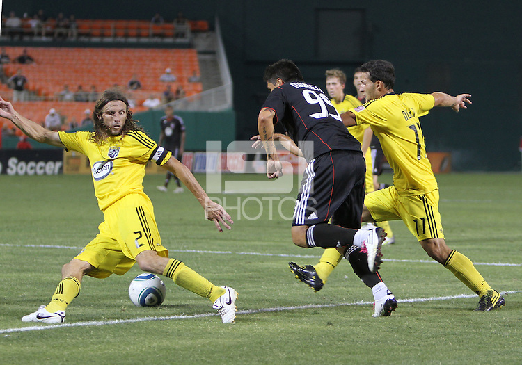 Jaime Moreno #99 of D.C. United breaks past Dilly Duka #11 and Frankie Hejduk #2 of the Columbus Crew during a US Open Cup semi final match at RFK Stadium on September 1 2010, in Washington DC. Columbus won 2-1 aet.