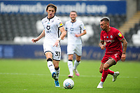 Conor Gallagher of Swansea City battles with Jack Hunt of Bristol City during the Sky Bet Championship match between Swansea City and Bristol City at the Liberty Stadium in Swansea, Wales, UK. Saturday 18 July 2020