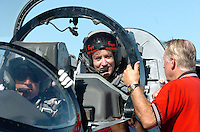 Oct 08, 2004 - WALNUT CREEK, CA, USA - Contra Costa Times reporter ROWENA COETSEE, left, gets a prefight briefing from ED DALEY of Antioch prior to her flight in an L-39 jet at Byron Airport in Byron, Calif., Friday Oct. 8, 2004. Piliot John Posson is at left. This jet and others from the Byron based aerobatic team  will perform during the Fleet Week air show over the San Francisco Waterfront this weekend..(Credit Image: © Alan Greth)