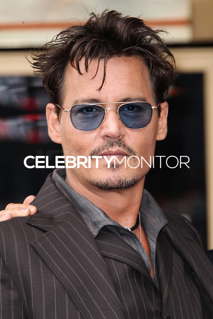 HOLLYWOOD, CA - JUNE 24: Johnny Depp attends the ceremony honoring Jerry Bruckheimer with a Star on The Hollywood Walk of Fame held in front of El Capitan Theatre on June 24, 2013 in Hollywood, California. (Photo by Celebrity Monitor)