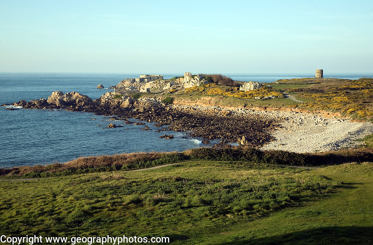 Fort le Marchant headland and loophole 'martello' tower, L'Ancresse bay Guernsey Channel Island