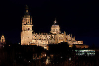 General view, Cathedral, Salamanca, Spain, pictured on December 19, 2010 at night, floodlit. Salamanca, Spain's most important University city,  has two adjoining Cathedrals, Old and New. The old Romanesque Cathedral was begun in the 12th century, and the new in the 16th century. Its style was designed to be Gothic rather than Renaissance in keeping with its older neighbour, but building continued over several centuries and a Baroque cupola was added in the 18th century. Restoration was necessary after the great Lisbon earthquake, 1755. Picture by Manuel Cohen