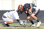 Palos Verdes, CA 04/12/13 - Kan Yamamoto (Peninsula #12) and Nicholas Heller (Beverly Hills #2) in action during the Beverly Hills vs Peninsula Varsity Boys Lacrosse game.  Peninsula defeated Beverly Hills 8-5.