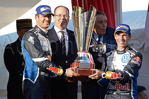 24.01.2016. Monte Carlo, Monaco, France. WRC Monte Carlo Rally 2016, final day. Sebastien Ogier (FR) and Julien Ingrassia (FR) win the race in their Volkswagen Polo WRC and accept the trophy from Prine  Albert of Monaco
