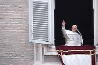 Pope Francis waving to the crowd at St Peter's square during his first Angelus prayer at the Vatican on March 17, 2013