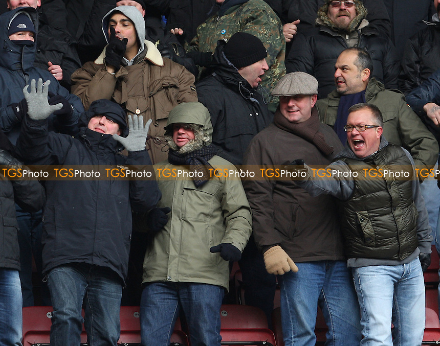 Millwall fans - West Ham United vs Millwall, npower Championship at Upton Park, West Ham - 04/02/12 - MANDATORY CREDIT: Rob Newell/TGSPHOTO - Self billing applies where appropriate - 0845 094 6026 - contact@tgsphoto.co.uk - NO UNPAID USE.