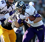 MANKATO, MN - NOVEMBER 1:  Max Mickey #22 for the University of Sioux Falls gets a key first down past Colt Nero #51 from Minnesota State Mankato in the fourth quarter Saturday afternoon at Blakeslee Stadium in Mankato. (Photo by Dave Eggen/Inertia)