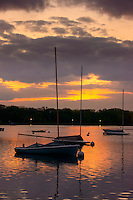 Sunrise over sailboats at Lake Harriet.