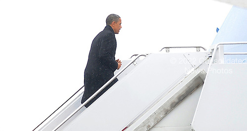 U.S. President Barack Obama boards Air Force One at  Andrews Air Force Base, under a gusty and icy January 26, 2011 in Washington, DC. Obama is traveling to Manitowoc, Wisconsin..Credit: Olivier Douliery / Pool via CNP